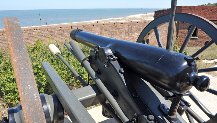 Cannon Aimed at Guy Fishing on Beach