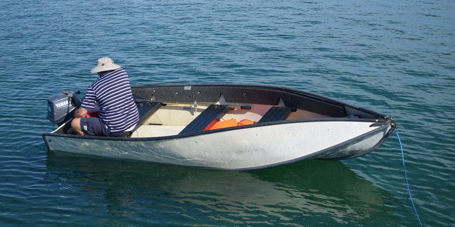 Mark checks out a dinghy that is available to trade