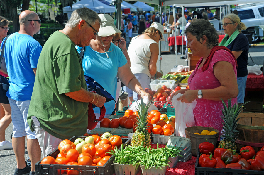 Cindy buying fresh veggies at the farmers market