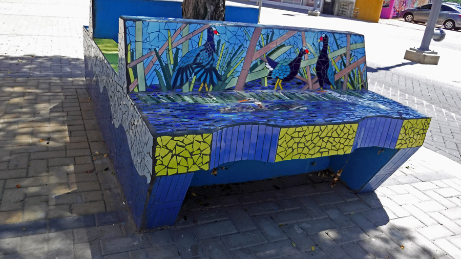 The benches in San Nicolas are covered with colorful tile mosaics
