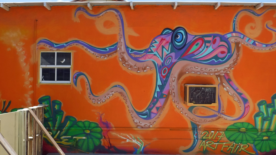 The octopus wraps about the window and AC unit