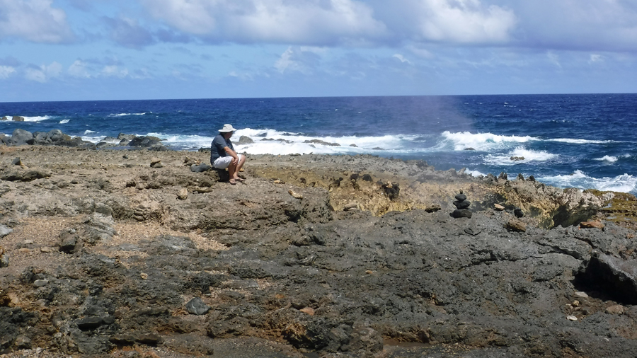 Mark parks on a rock and takes in the view and watches the blow holes