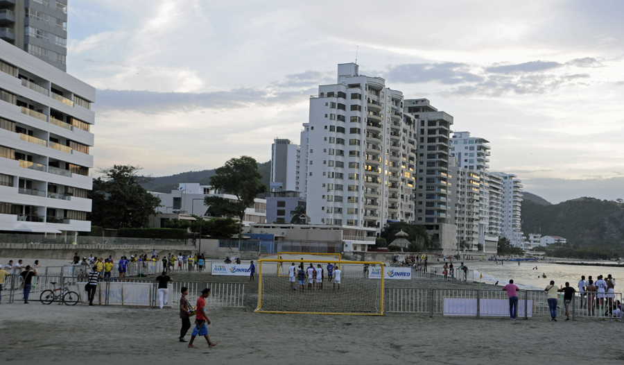 A five-a-side football game wraps up on the beach