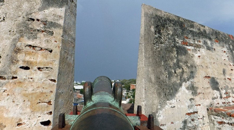 Cannon pointing to city below from the top tier