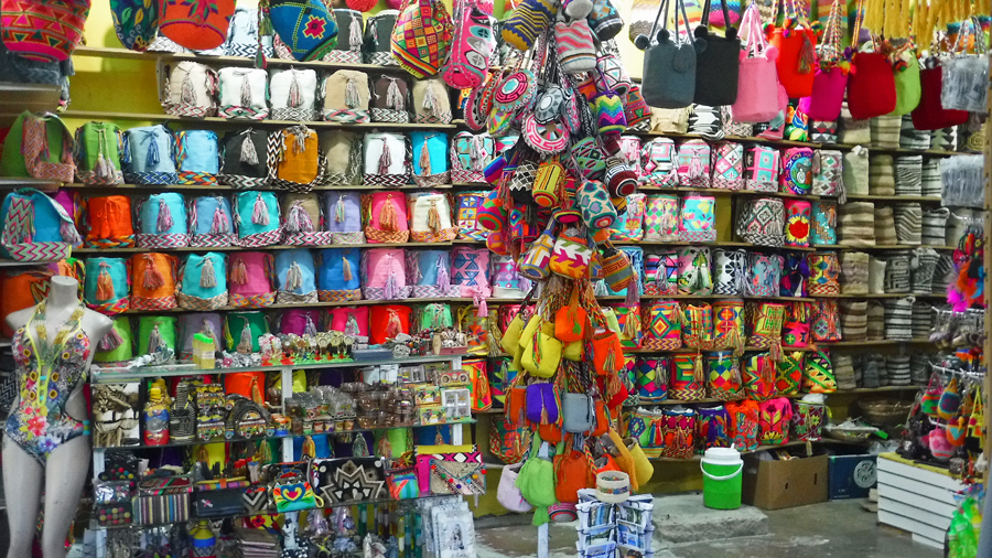 Colorful Colombian bags are all the rage here for both men and women (Cindy got one for Christmas - note the missing bag)