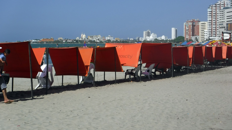 Shade for rent on the beach- Walled City in the far background