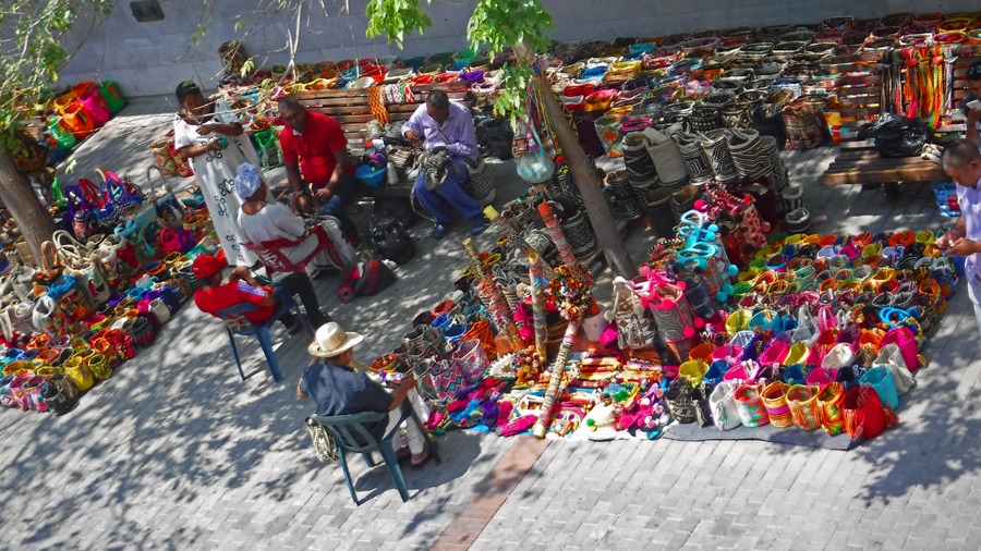 Colorful crafts being made and sold outside the Museum