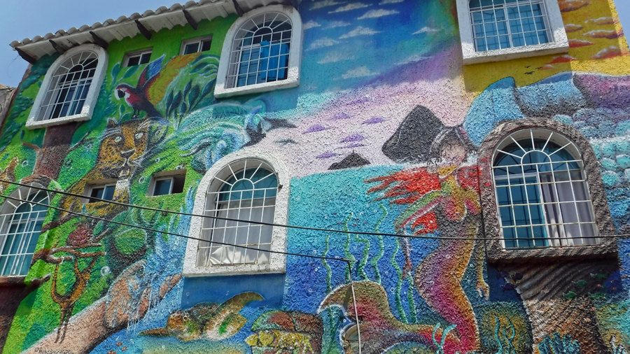 So much going on with this home mural - do you see the guy kissing the mermaid?