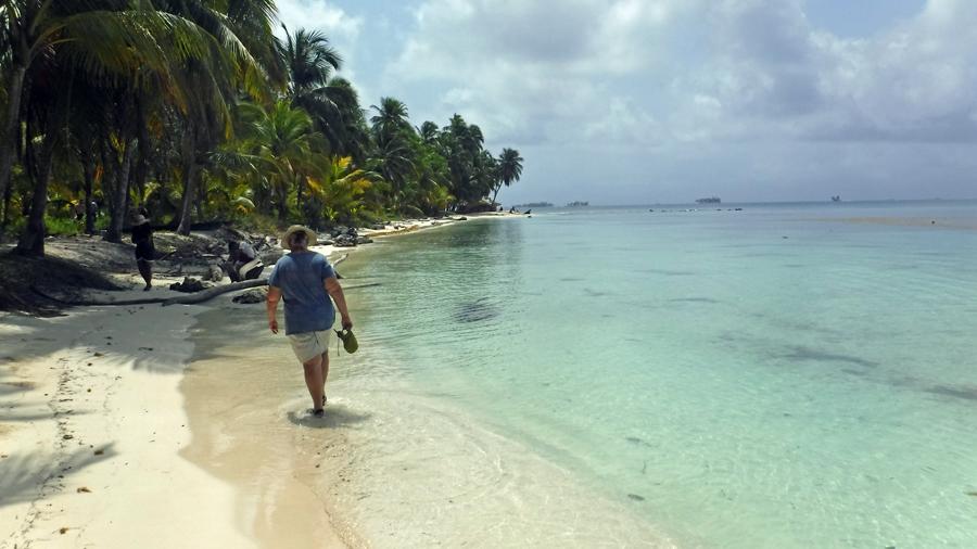 Cindy walking the beach on Uchutupu Dummat