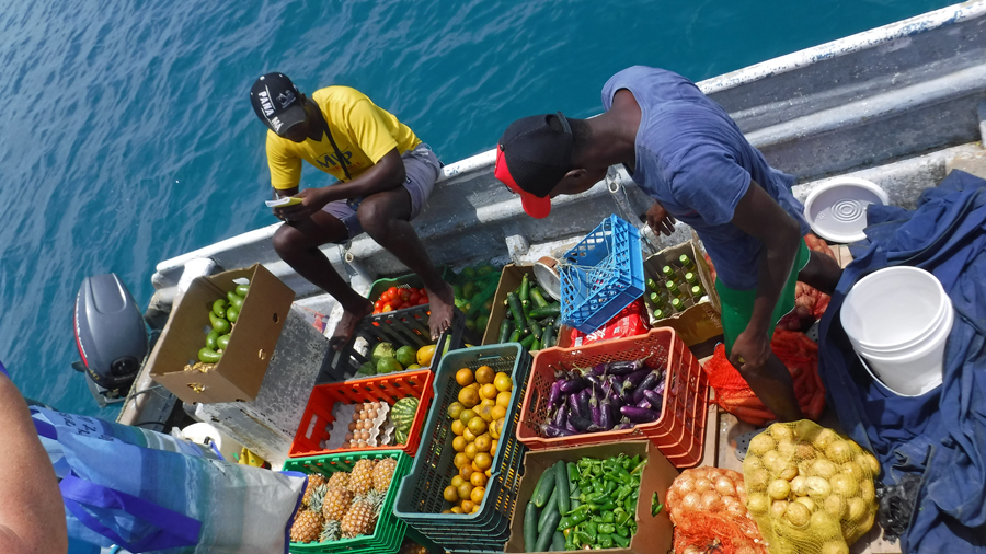 The veggie boat arrives and we replenish our produce and fruit